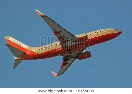 Southwest Airlines airplane after take off with blue sky