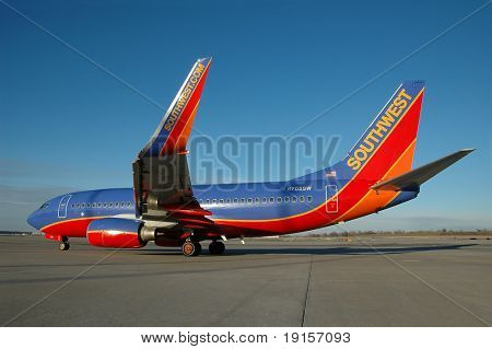 Southwest Airlines plane on the tarmac with blue sky