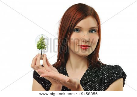 Young businesswoman with bulb and tree isolated on a white background