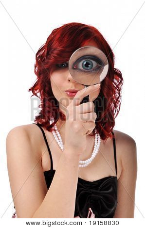 Woman with magnifying glass isolated against a white background