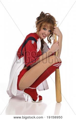 Pinup girl posing with a baseball bat against a white background