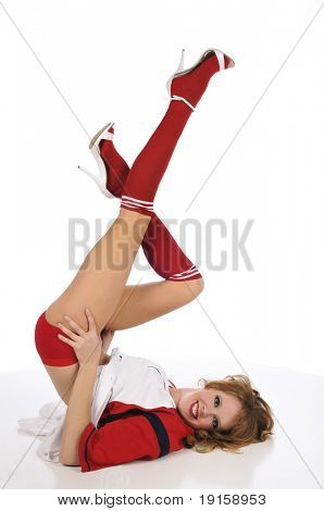 Pinup girl posing with a baseball uniform against a white background