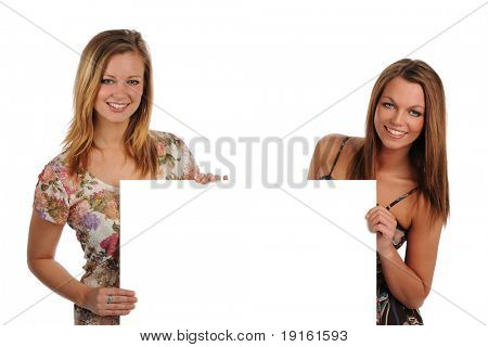 Two beautiful Young Women holding a blank sign isolated on a white background