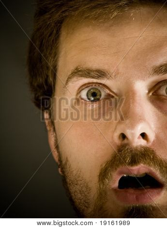 Close-up portrait of very amazed guy