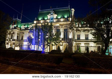 City-hall building illuminated at night, in Iasi, Romania