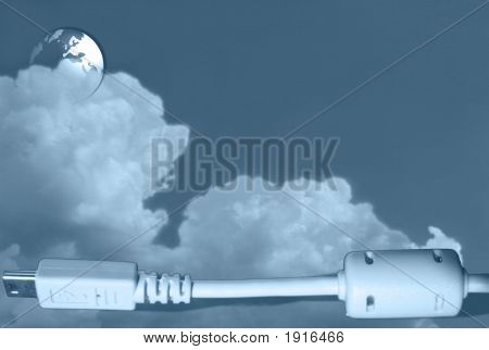 Blue Cloudy Background With A Usb Cable