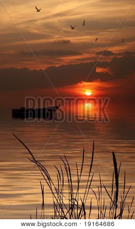 A boat on the lake in sunset time