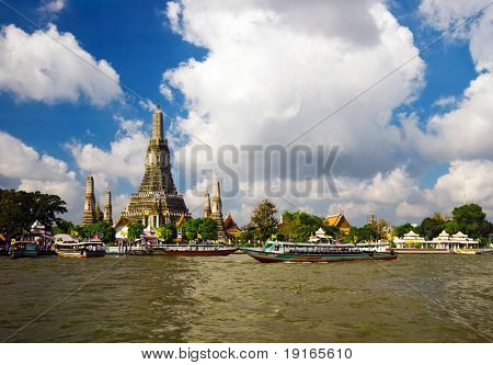 Buddhist temple on the river. Photographed on Chaopraya river in Bangkok. Kingdom Thailand.