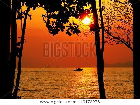 Tropical sunset with sea and boat. Koh Lanta island. Thailand