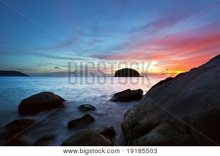 Tropical sunset in the sea. Phuket island. Thailand