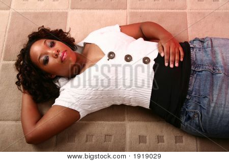 African American Girl Laying On The Floor Relaxing