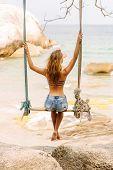 Beautiful Woman On Swing In Tropics. poster