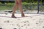 Close Up On Feet Walking On Tightrope Or Slackline Outdoor At The Beach poster