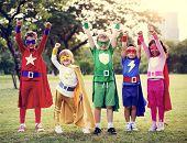 Kids Wear Superhero Costume Outdoors poster