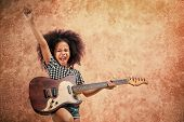 Afro-American little girl playing guitar on grunge background poster