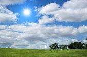 stock photo of sun rays  - Landscape with clouds and trees - JPG