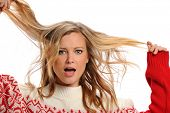 foto of pulling hair  - Young Blond Woman pulling her hair isolated on a white background - JPG