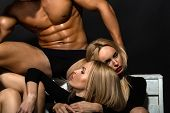 Man With Muscular Body With Twin Girls poster