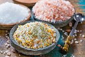 Постер, плакат: Three Different Types Of Natural Salt In Stone Bowls On Wooden Surface White Sea Salt Pink Himalay