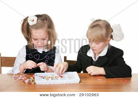 Two Girls Busy With Handicraft