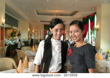 Two Restaurant Staff At Work