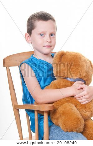 Sweet boy with bear in rocker