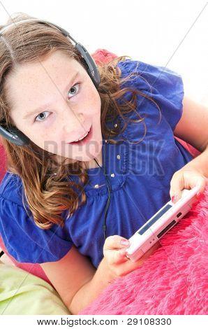 Girl playing handheld video game