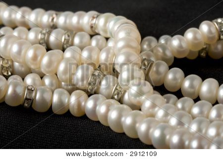 Pearl Necklace On Black Background