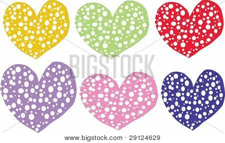 A Few Hearts Are On A White Background