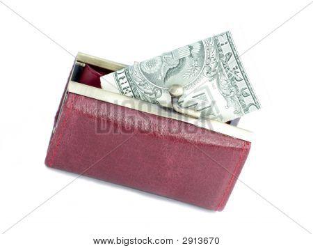Dinheiro em uma bolsa vermelha