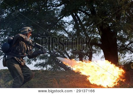 KIEV, UKRAINE - SEPTEMBER 6, 2008:  Person in German WW2 military uniform with flame-thrower.  Historical military reenacting in Kiev, Ukraine, September 6, 2008.