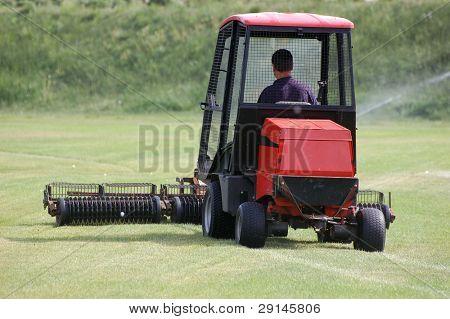 A red lawn mower.Golf club. Kiev,Ukraine.