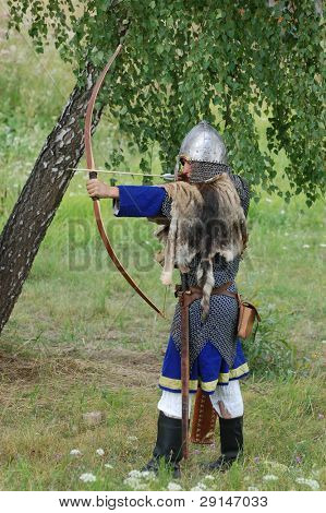 KIEV, UKRAINE - JULY 31: Member of history club Golden Capricorn wears  medieval costume as he participates in historical festival and camp in memory King Vladimir July 31, 2009 in Kiev, Ukraine.