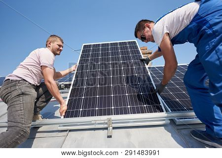 Male Workers Installing Standalone Solar