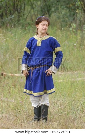 KIEV, UKRAINE - JULY 31: Member of history club Golden Capricorn wears medieval costume as he participates in historical festival and camp in memory King Vladimir July 31, 2009 in Kiev, Ukraine