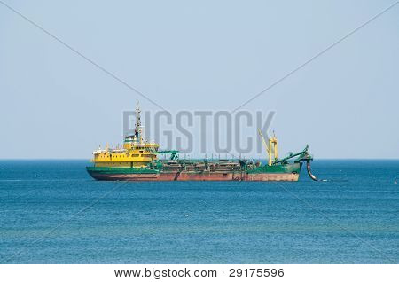 Dredger Ship Working At Sea