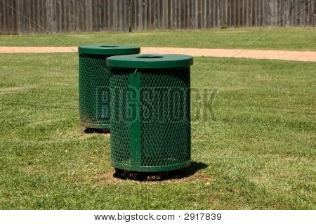 Green Trash Bins In A Park