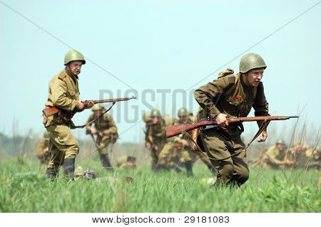 KIEV, UKRAINE - MAY 10 : Members of Red Star history club wear historical Soviet uniform during historical reenactment of 1945 WWII, May 10, 2010 in Kiev, Ukraine