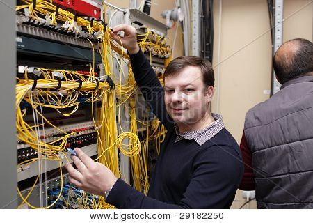 Technician Posing At Server Room