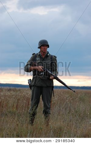 CHERNIGOW, UKRAINE - AUG 29: Member of Red Star military history club wears historical German uniform during historical reenactment of WWII, August 29, 2010 in Chernigow, Ukraine