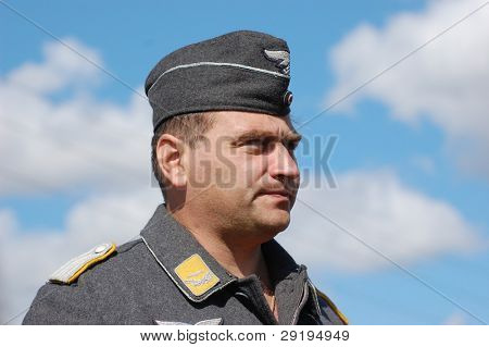 KIEV, UKRAINE -SEPT 17 : Member of Red Star history club wears historical German Luftwaffe uniform during historical reenactment of WWII, September 17, 2011 in Kiev, Ukraine