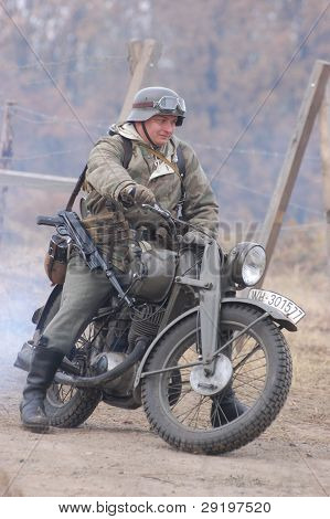 KIEV, UKRAINE -NOV 6: Unidentified member of Red Star history club wears historical German uniform during historical reenactment of WWII, November 6, 2011 in Kiev, Ukraine
