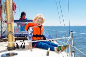 Kids Sail On Yacht In Sea. Child Sailing On Boat. Little Boy And Girl In Safe Life Jackets Travel On poster
