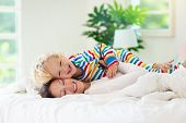 Mother And Child In Bed. Mom And Baby At Home. poster