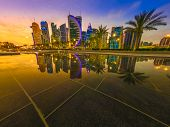 Skyline Of Doha, Qatar. Scenic Cityscape Of West Bay Skyline At Blue Hour Reflecting In The Water Of poster