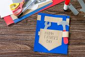 Greeting Card With Happy Fathers Day On Wooden Table. Childrens Art Project Craft For Kids. Craft F poster