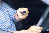Man Sitting In Car And Showing Car Key To Dealer. Auto Business, Car Sale, Car Rental Consumerism Bu poster
