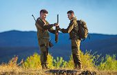 Masculine Hobby Activity. Men Bearded Hunters With Rifle Nature Background. Experience And Practice  poster