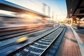 Railway Station With Motion Blur Effect At Sunset. Industrial Landscape With Railroad, Blurred Railw poster