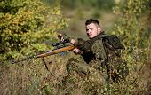 Hunter Hold Rifle. Man Wear Camouflage Clothes Nature Background. Hunting Permit. Bearded Serious Hu poster